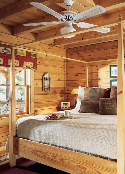 Four-poster log-home bedroom
