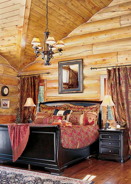 Distressed sleigh log-home bedroom