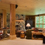 Hundred-year-old Douglas fir beams from an old manufacturing plant form the structural support for the home and enhance the finished lower-level rec room. A third wood-burning fireplace is the focal point.