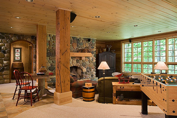 For love of logs a rustic log home in michigan for Log cabin with basement