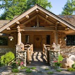 Handcrafted red pine logs, bolstered by stonework, a custom door and two 22-foot log beams supporting the king-post porch truss create a rustic look.