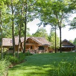 Evan and Terri Dufendach's handcrafted log home is set in a wooded, secluded area near Grand Rapids, Michigan. Built by Evan, with help from Dennis Carpenter of Sawmill Creek Woodworking, it has attached three-car and five-car garages, a finished walkout level and a 40-by-80 storage barn.