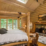 Skylights in the cathedral ceiling provide natural illumination for the master bedroom, which features a custom-built four-poster bed made from the gnarliest wood the furniture maker could find.