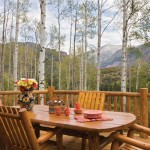 Mount Sopris dominates the skyline and provides a breathtaking view for the Hudsons when they dine al fresco. The custom railing is made of hand-hewn lodgepole pine.