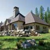 A steeply pitched roof sets the tone for French Country style. Stonework anchors the home to its woodsy setting.