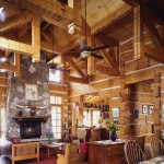 The great room showcases wide logs and chinking, interior dovetail corners and hand-hewn timber trusses. The room's focal point is the two-story fireplace that mixes natural and manufactured stone. The back side forms a fireplace on the deck. A church pew highlights the rugged wood furniture.