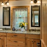 Jack created a custom-designed loft in his log home. Split into two separate bedrooms, the loft also includes a shared bathroom, which comes complete with neutral-toned granite countertops and side-by-side matching vanity mirrors.