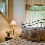 """We wanted to include a mix of materials in the home to kind of break up the large amount of wood,"" says Jack. They used quite a bit of drywall, like in the upper-level master bedroom, and also incorporated cedar tongue-and-groove ceilings."