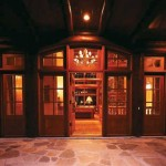 Log-trimmed arched transoms in the front entry mimic interior arches to tie the spaces together.