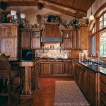 Gary Severson designed the stylish kitchen, using drawknifed white cedar to create granite-topped cabinets with character. Booted cedar posts add personality to the island. A blacksmith fashioned the baker's rack and brackets supporting the banded hood vent from aged metal for a copper-like appearance.