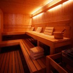 The lower-level sauna features windows to enjoy a view of nature before heading to the lake for a swim.