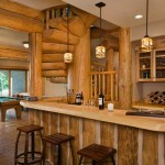 The lower level is built for entertaining, with a wet bar, recreation room, comfortable seating, a wine cellar, the home's only TV and a fireplace. An expansive storage room behind the bar houses sporting goods such as ski boots, water skis, sleds and ice-fishing augers.