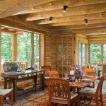The dining room leads to the bright sunroom, another seating area where family and friends eat breakfast, put together puzzles, and play cards and games while enjoying the woodland view.