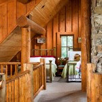 A wide catwalk in the loft leads to a cozy sleeping area on each end. This comfortable haven offers a bird's-eye view of the cabin and its outdoor surroundings.