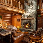 The centerpiece of the great room is clearly the soaring stone fireplace, which features Montana moss rock that matches the home's exterior stone. This view of the home shows the loft-level catwalk that connects two upper-level sleeping areas. The elk head displayed above the fireplace is one of Sean Hinchey's hunting trophies.
