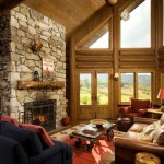 One end of the home's great room extends outward in an angled prow and enhances views of the valley and mountain peaks. The dual-sided stone fireplace and chimney are made from material quarried in Oakley, Idaho, with the opposite side serving the exterior deck.