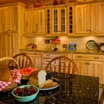 To make it easy for guests to locate dishes, Pat designed the cupboards with glass fronts. Undercabinet lighting provides necessary workspace illumination and highlights key decor.