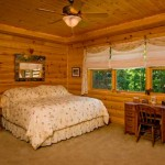 """At first, the couple planned to live in the log home for a time, then move to a smaller house with a zero-carbon footprint as they got older. But they designed the master bedroom on the first floor with handicap access and extra-wide doorways. """"The more we live here, the more we want to stay and never leave,"""" Pat says."""