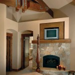 The master suite's corner fireplace combines Colorado buff sandstone and moss rock.