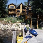 The dock is just a quick jaunt from the back deck, which envelops the rear of the home with plenty of extra living space.