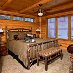 All rooms at the Smith cabin come with a view of North Lake. Bedrooms are outfitted with bark on hickory furniture and Savoy House ceiling fans.