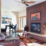 The gas-burning fireplace in the walkout lower level rec room actually was constructed of stucco and faux-finished to look like antique brick.