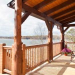 The view of the lake from the deck encourages relaxation. Hand-hewn beams and rafters add to the rustic charm of the space.