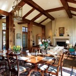 True plaster walls, a stone fireplace and massive wood beams underscore this Montana home' French feel. The living and dining area opens onto terraces on both sides.