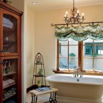 "On the ""heres"" side of the master bath, a sparkling chandelier shines on a distinctive soaking tub. The ""his"" side of the bath offers a walk-in shower."