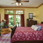 Cedar log home master bedroom suite with red accents and antiques