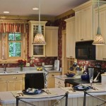 Cedar log home family-style kitchen with yellow cabinets and Corian solid-surface counter.