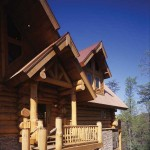 """The home uses several different roofing materials, including a copper-colored metal roof. """"It will never fade or patina out,"""" Pam Johnson says, """"and it is much less expensive than a true copper roof."""" Western red cedar used in the fascia and soffits complements the full-round eastern white pine logs."""