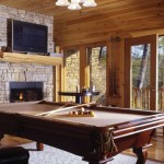 The game room in the lower level is the perfect place to unwind, with features such as a pool table, fireplace, large-screen TV, pub table and access to an outdoor patio.