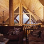 Overlooking the great room, the open loft is outfitted with chocolate-brown sleeper sofas. The vaulted pine tongue-and-groove ceiling brings both warmth and definition to the space.