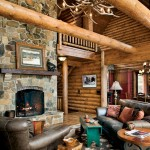 The sturdy log truss system results in a soaring peaked ridgeline in the great room. Pine tongue-and-groove decking provides an elegant finish for the ceiling. Completing the rustic look, large-diameter, hand-peeled pine logs form a king-post pattern frame for the glass-filled gable.