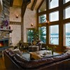 Charlie and Lauren Bisbee worked with their designer to give their great room the best views in the house. When night falls and the view fades, all eyes turn to the handsome corner fireplace.
