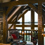 he loft is a cozy reading area and a place to appreciate the home's timber framing.
