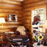 In the early days when the country was being settled, the pioneers frequently transported the furnishings they had brought from the old country to their homesteads in the West. Pairing reproduction French country chairs with those covered with natural cowhide in the seating area of the great room reminds Karen of how the original Rocky Mountain log cabins must have been furnished. The Native American carving was a gift from her parents and traveled with a truck load of golf carts from South Carolina to its new home in Colorado.