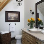 Low-flow toilets and an on-demand hot-water heater keep the bathroom's efficiency in check. The natural stone flooring serves as the perfect thermal mass through which to capture heat, while a venting skylight overhead helps summer heat escape.