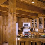 "Rustic hickory cabinets and simple white appliances bring homey good looks to the kitchen. While the gleaming granite counters hint at a modern-day pedigree, the immense hand-hewn pine beams say, ""I could've been here 200 years."""
