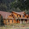 To take advantage of the mountain setting and nearby river, this log home features ample windows and plenty of deck space