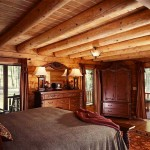 The Pitcocks wanted the home's design to include a large, inviting master bedroom. The 18-by-20-foot bedroom provides access to the enchanting wraparound porch. Tim, who prefers traditional country decor, chose the attractive wood bedroom suite.