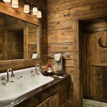 The Winkels went rustic and whimsical in the basement bathroom. The door with the crescent moon leads to a bathroom designed to resemble an outhouse. Guests are relieved to discover modern plumbing.