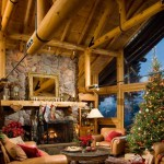 The original builder cut the chord of the open-beam truss system and inserted black steel tie rods to keep the log from interrupting the view through the expansive living room windows.