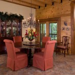 The dining area features a custom walnut table with inlaid granite, which seats four to six—ideal for intimate dinner parties.