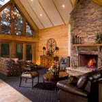 The great room's three sets of French doors open to the deck and yield unobstructed views of the water. Peaked ceilings mix log, timber and drywall to enhance the windows and lighting.
