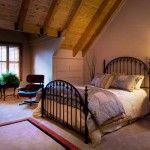 One of the master suites includes a large dormer and drawers built into the half wall.