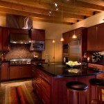 The kitchen—where everyone loves to congregate during get-togethers—has a sophisticated edge thanks to custom cabinetry with a cranberry-cabernet lacquer and absolute-black granite counters.