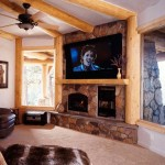 Because Mike and Susan wanted their great room to focus on the outdoors, family and guests head downstairs to take in movies and television.