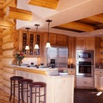 Custom cabinetry helps give the kitchen a homey look that fits with the mountain theme.